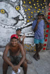 Residents of Brazilian artist Bel Borba's hometown, Salvador de Bahia, with his artwork, as seen in BEL BORBA AQUI, directed by Burt Sun and André Costantini, with his work. Courtesy of Abramorama.