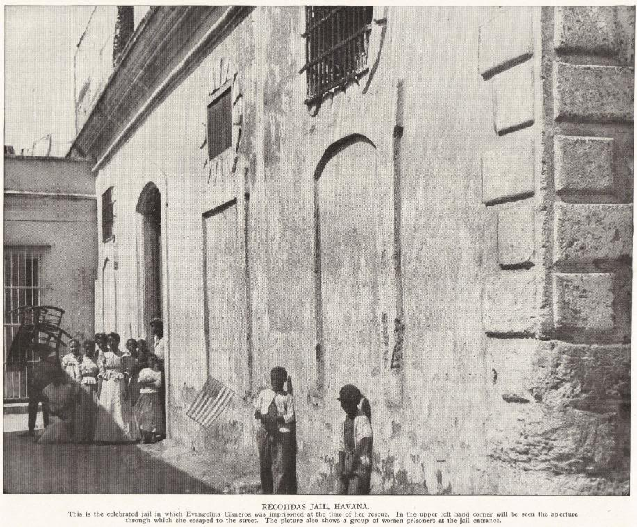 RECOJIDAS JAIL, HAVANA: This is the celebrated jail in which Evangelina Cisneros was imprisoned at the time of her rescue. In the upper left hand corner will be seen the aperture through which she escaped to the street. The picture also shows a group of women prisoners at the jail entrance.