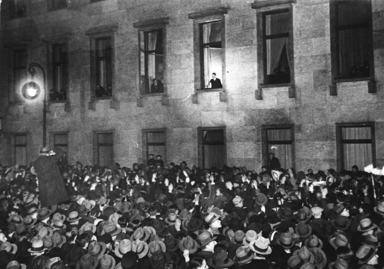 Adolf Hitler inaugurated as Chancellor of Germany on January 30, 1933. Here Hitler looks out of a Chancellory window at a crowd of admirers. While in the short-term Hitler somewhat improved Germany's economy, his poor leadership ultimately left the country in complete disarray. Within little more than a decade, millions of German Jews had been killed or fled. By 1945, millions of German civilians and servicemen had lost their lives. In 1945, Germany was a devastated land. Germany would spend the following 45 years divided between East and West.