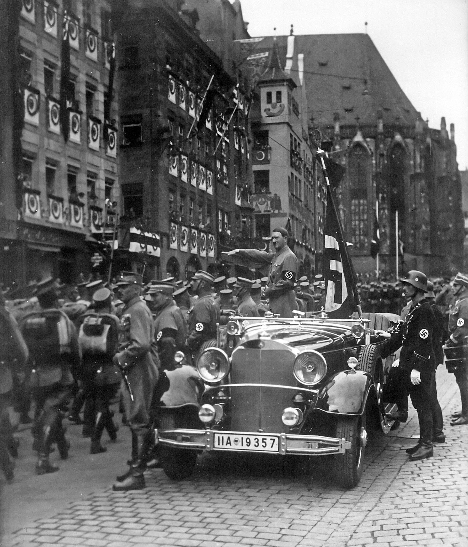 Adolf Hitler viewing a parade of SA troops in Nuremberg, Germany, in September of 1935.  Following Hitler's defeat less than ten years after this photograph was taken, Nuremberg would be the setting for war crimes trials related to the brutal killings perpetrated by members of the Nazi party and their ilk.