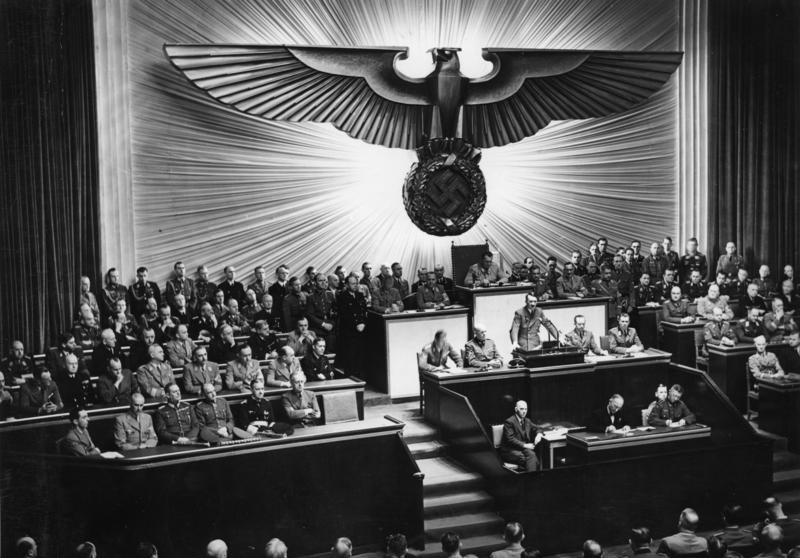 Adolf Hitler addressing the German Reichstag on December 11, 1941. Hitler is giving a speech opposing the actions of American President Franklin D. Roosevelt. On December 7, 1941, Japanese forces attacked the United States at Pearl Harbor, Hawaii.  The following day (December 8, 1941), U.S. President Roosevelt asked Congress for, and received a declaration of war against, Japan.  On December 11, 1941, the United States declared war against Germany.