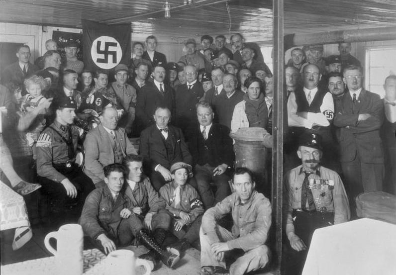 Adolf Hitler at an NSDAP meeting of the Munich, Germany, Braunes Haus, in December, 1930.