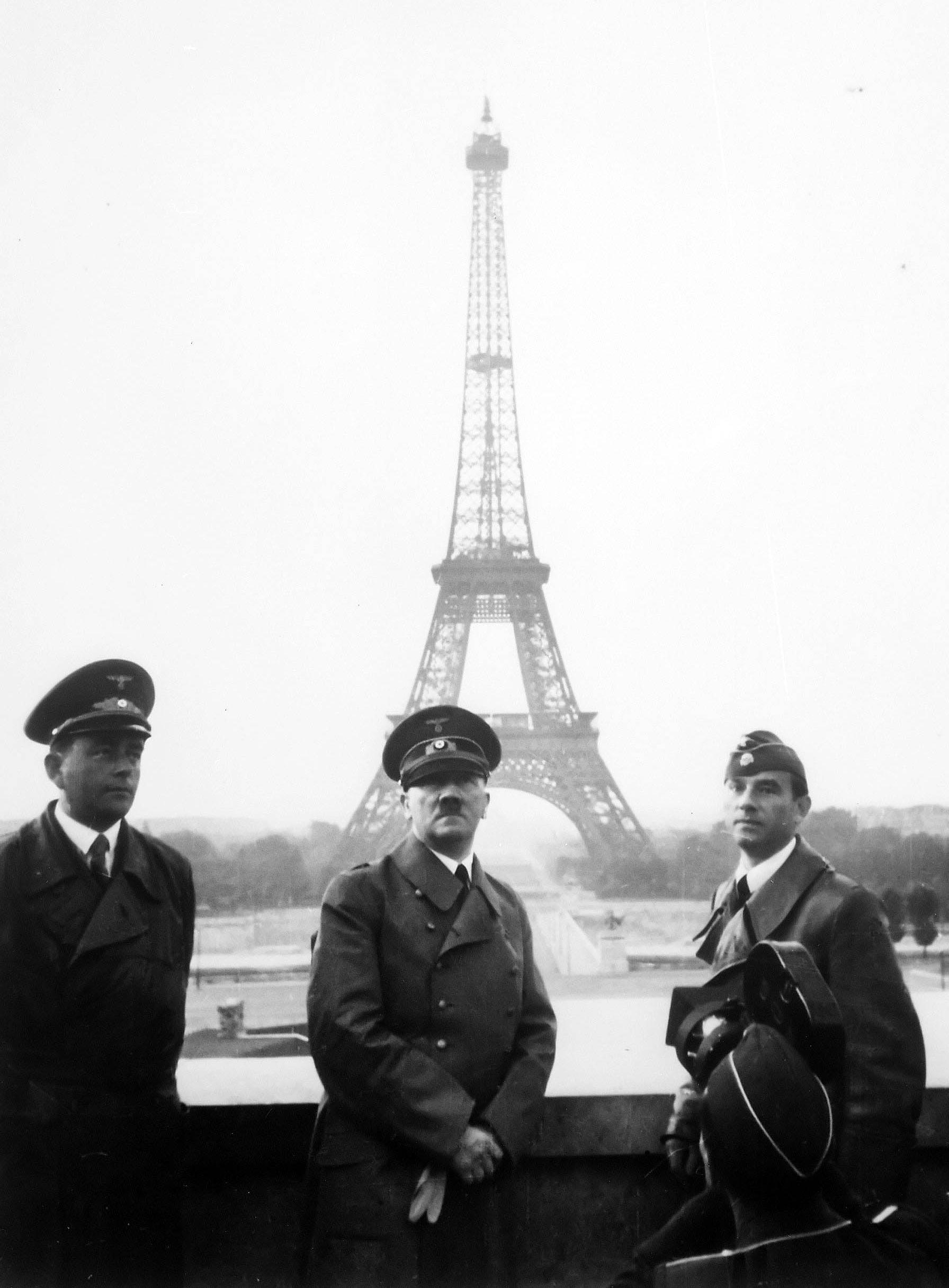 Adolf Hitler touring Paris, France, on June 23, 1940. The Eiffel Tower is visible in the background.  The day before (June 22), France signed an armistice with Germany following the Germans' successful invasion.