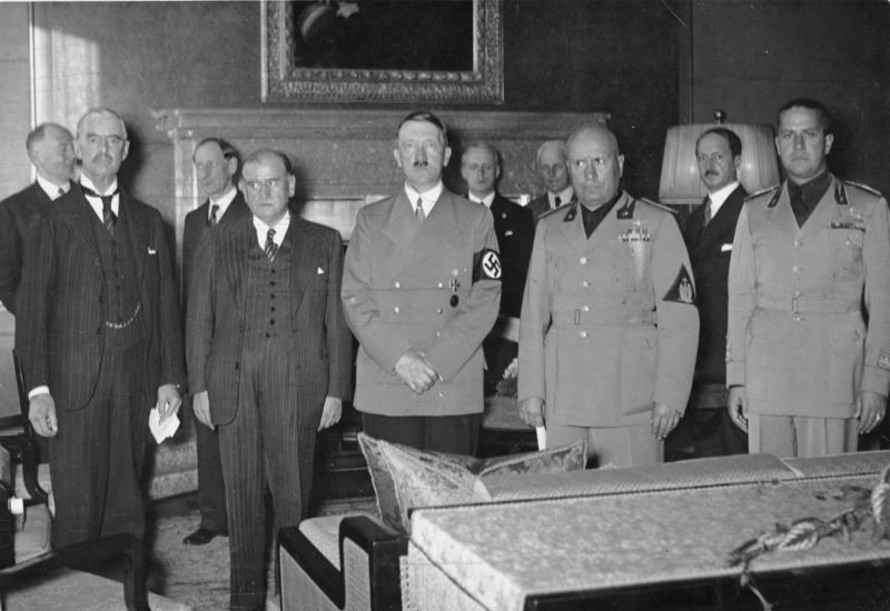 "Munich Conference, September 29, 1938. Pictured in the front of the photograph are, from left to right: British Prime Minister Neville Chamberlain, French President Edouard Daladier, German Führer Adolf Hitler, Italian ""Il Duce"" Benito Mussolini, and Italian Foreign Minister (and Mussolini's son-in-law) Galeazzo Graf Ciano."