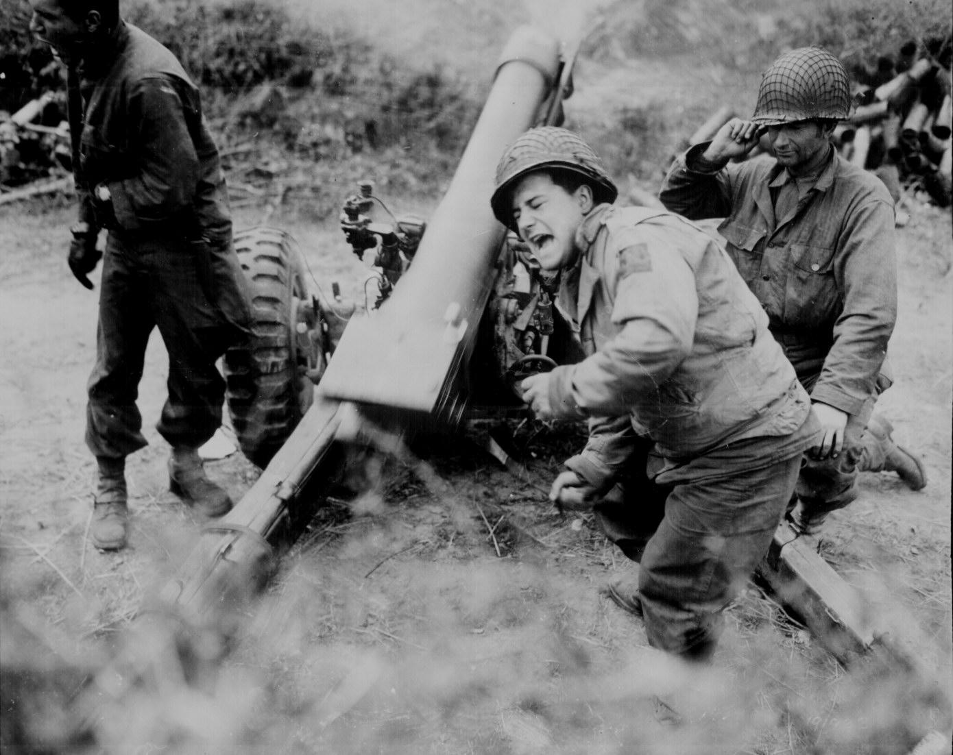 American Howitzer in Action During World War II