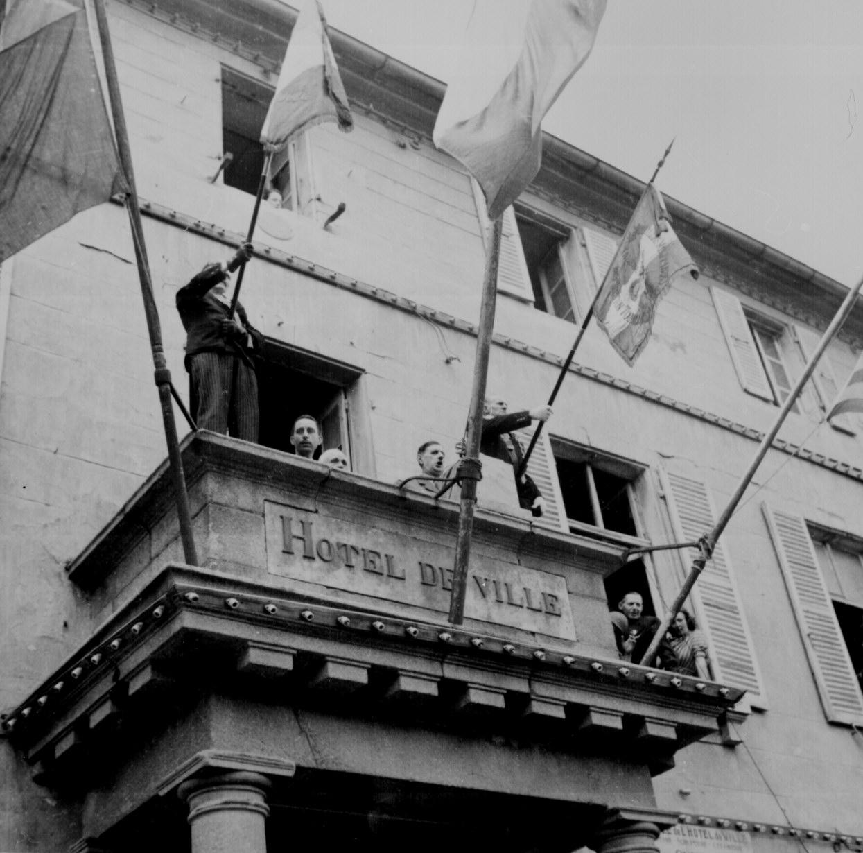 General Charles de Gaulle addressing a crowd from the balcony of the Hotel de Ville, 1944.