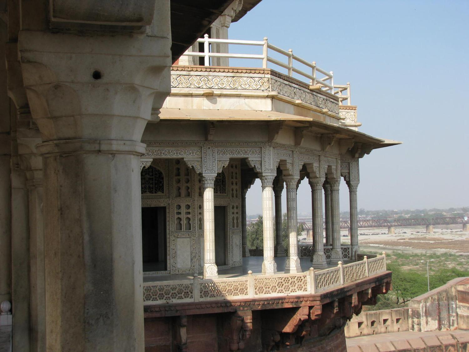 A pillared porch overlooking Agra Fort in India.  Agra, a walled palatial city, was home to several Mugal (Mughal or Mogul) emperors, including Humayun, Akbar, Jehangir, Shah Jahan, and Aurangzeb.