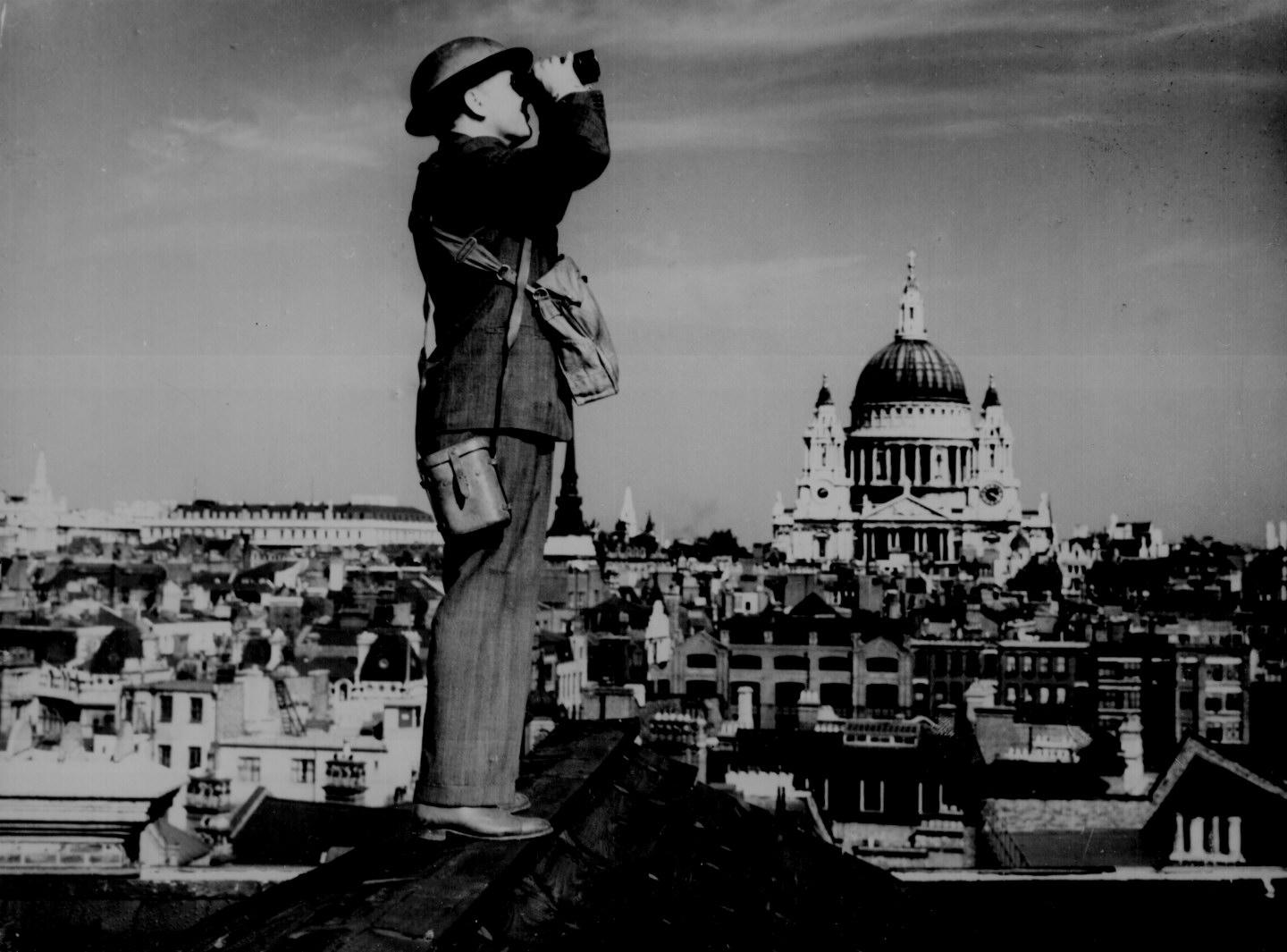 Here is an aircraft spotter on the roof of a building in London ...
